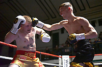 Rhys Edwards (black shorts) defeats Robbie Forster during a Boxing Show at York Hall on 30th November 2018