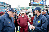 January 01, 2010:   Florida State head coach Bobby Bowden talks with West Virginia coaches on the field prior to the start of the Konica Minolta Gator Bowl College football action between the West Virginia Mountaineers and the Florida State Seminoles played at the Jacksonville Municipal Stadium in Jacksonville, Florida on January 01, 2010.  Florida State defeated West Virginia 33-21.