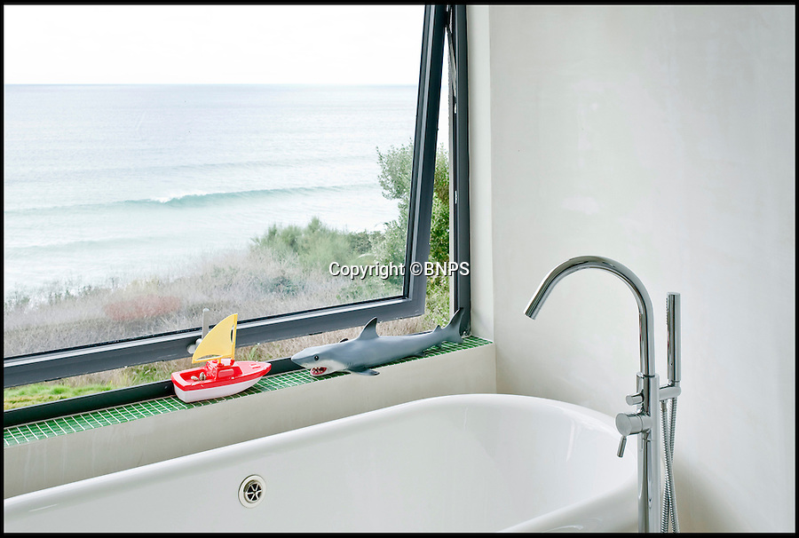 BNPS.co.uk (01202 558833)<br /> Pic: ForeverCornwall/BNPS<br /> <br /> ****Must use full byline****<br /> <br /> The bathroom.<br /> <br /> When a couple paid out £500,000 for a tumbledown cottage that was fit for nothing but demolition, a few eyebrows were raised among their friends.<br /> <br /> But Alex Michaelis and Susanna Bell's gamble to buy the cliff-top property that had no central heating or electricity has paid off after they turned it into a stunning holiday home now worth three times the purchase price.<br /> <br /> Architect Alex made the most of the stunning views enjoyed from the plot and has ensured all main rooms of the new house, including the four bedrooms and five bathrooms, face the sea.<br /> <br /> They now rent out the modern seaside home overlooking Praa Sands, near Penzance, Cornwall for as much as £5,000 a week.