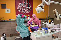 January 10, 2015 - Rawang (Malaysia). Dr. Azlina Jamaluddin works as a dentist at the Global Ikhwan Clinic in Rawang and she was one of the Obedient Wives Club Organiser. Educated in Australia she joined the company in 2001. © Thomas Cristofoletti / Ruom