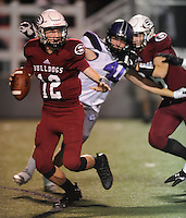 NWA Democrat-Gazette/ANDY SHUPE<br /> Eli Hale (center) of Fayetteville flushes Jack Lindsey (12) of Springdale Friday, Oct. 9, 2015, during the first half of play at Jarrell Williams Bulldog Stadium in Springdale. Visit nwadg.com/photos to see more photographs from the game.