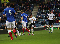 Kevin Kyle tackled by Derek Young in the Rangers v Queen of the South Quarter Final match in the Ramsdens Cup played at Ibrox Stadium, Glasgow on 18.9.12.