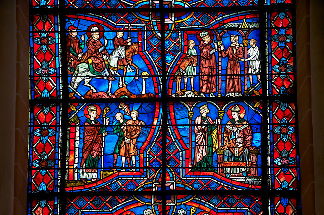 Medieval stained glass Window of the Gothic Cathedral of Chartres, France - dedicated to the Life of St Remigius (Remy).  A UNESCO World Heritage Site.