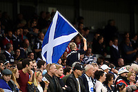 A young Scotland fan in the crowd waves a flag in support. Rugby World Cup Pool B match between Scotland and Japan on September 23, 2015 at Kingsholm Stadium in Gloucester, England. Photo by: Patrick Khachfe / Onside Images