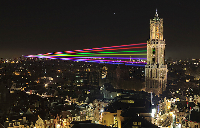 A seven colored laserbeam is projected on the Dom tower from a University building three kilometers away in Utrecht March 22, 2011. The laser show lasts a week and commemorates the 375 th anniversary of the Utrecht University. REUTERS/Michael Kooren
