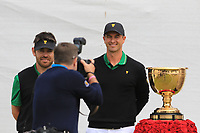 Louis Oosthuizen (International) and Adam Scott (International) on the 1st tee during the Second Round - Foursomes of the Presidents Cup 2019, Royal Melbourne Golf Club, Melbourne, Victoria, Australia. 13/12/2019.<br /> Picture Thos Caffrey / Golffile.ie<br /> <br /> All photo usage must carry mandatory copyright credit (© Golffile | Thos Caffrey)