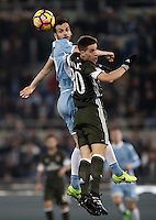Calcio, Serie A: Lazio, Stadio Olimpico, 13 febbraio 2017.<br /> Lazio's Marco Parolo (l) in action with Milan's Mario Pasalic (r) during the Italian Serie A football match between Lazio and Milan at Roma's Olympic Stadium, on February 13, 2017.<br /> UPDATE IMAGES PRESS/Isabella Bonotto