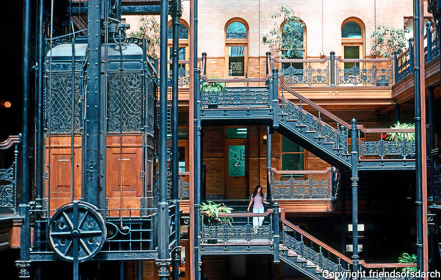 Los Angeles: Bradbury Building--Detmil, elevators. Cage elevator with wrought-iron grillwork.  Photo '78.