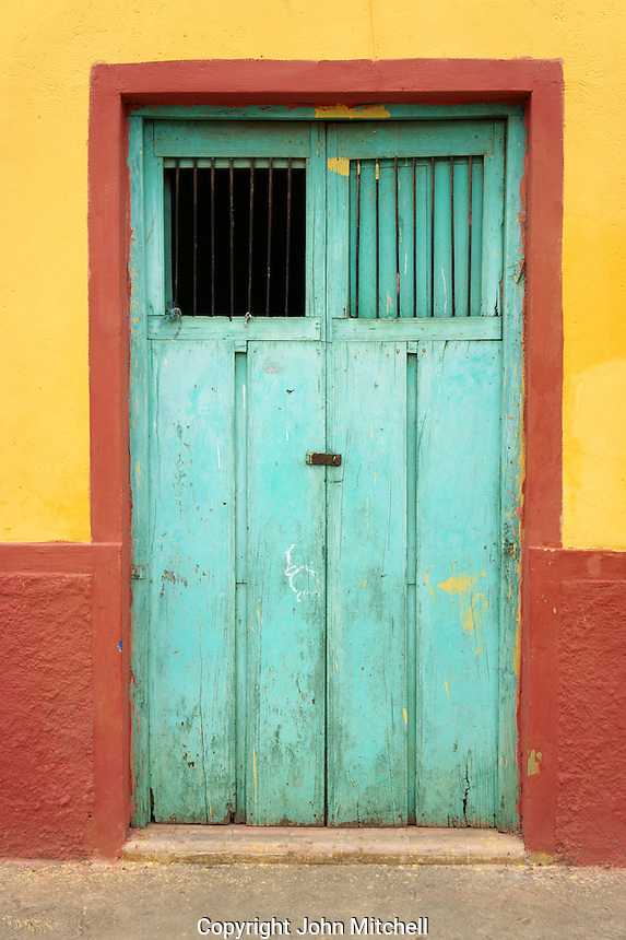 Old wooden door of a house in Santa Elena, Yucatan, Mexico.