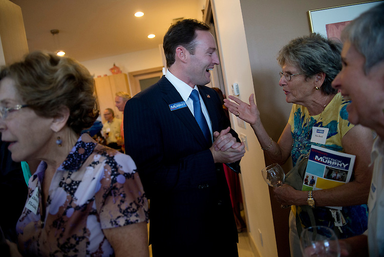 "UNITED STATES - AUGUST 23:  Patrick Murphy, democratic candidate in Florida's 18th District, talks with Nina Barcik at an event in Sewalls Point, Fla., entitled ""Women for Patrick Murphy.""  Murphy is running against Rep. Allen West, R-Fla.  (Photo By Tom Williams/CQ Roll Call)"
