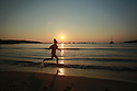 PINARELLO, PORTO VECCHIO, Corsica, France: 03/08/2018: Young children play in the early morning sunrise on the plage du Pinarello (Pinarellu in Corsican) near  Porto Vecchio in Corscia, France, Friday, August 3rd, 2018. Hot air from Africa is bringing a new heatwave to Europe, prompting health warnings about Sahara Desert dust and exceptionally high temperatures that are forecast to peak at 47 degrees Celsius in some southern areas. Photo/Paul McErlane