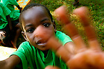 A student at Kyabirwa Children's Centre in Jinja, Uganda reaches for my camera