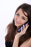 A young woman on a cordless phone