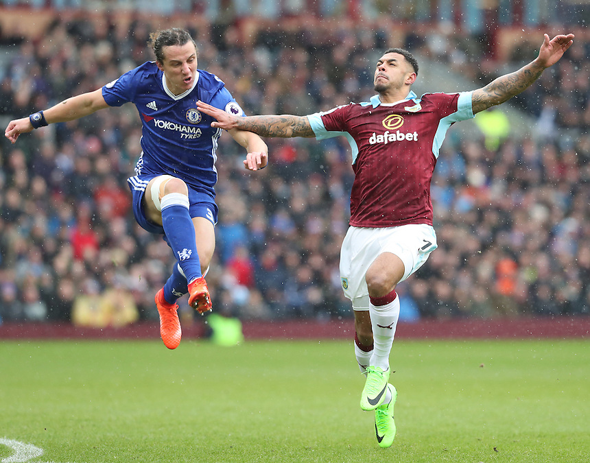 Chelsea's Marcos Alonso and Burnley's Andre Gray<br /> <br /> Photographer Rachel Holborn/CameraSport<br /> <br /> The Premier League - Burnley v Chelsea - Sunday February 12th 2017 - Turf Moor - Burnley<br /> <br /> World Copyright &copy; 2017 CameraSport. All rights reserved. 43 Linden Ave. Countesthorpe. Leicester. England. LE8 5PG - Tel: +44 (0) 116 277 4147 - admin@camerasport.com - www.camerasport.com