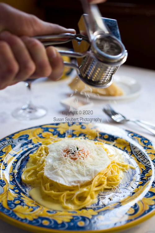 Buon Ricardo, an Italian restaurant located in the Paddington neighborhood in Sydney, NSW, Australia, specializes in truffled egg pasta. The pasta is tossed, (by the waiter at the table), with a white-truffle infused egg, reggiano parmesan, salt and pepper.  Yum.