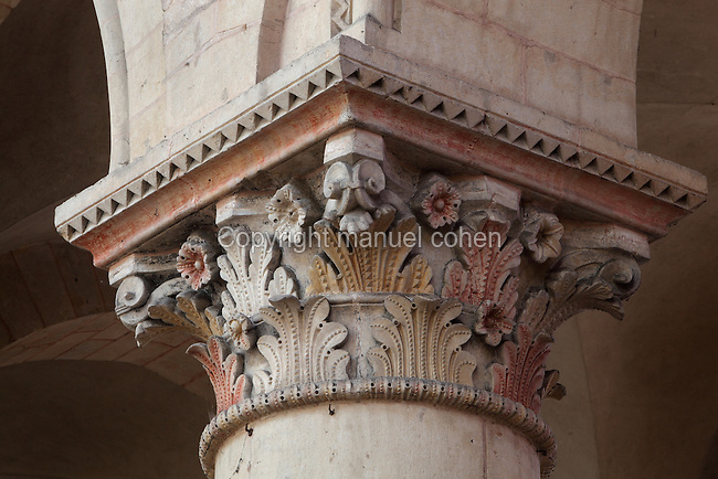Carved polychrome Romanesque capital, 12th century, with flowers and foliage of acanthus leaves, in the nave of the Cathedrale Saint-Julien du Mans or Cathedral of St Julian of Le Mans, Le Mans, Sarthe, Loire, France. The cathedral was built from the 6th to the 14th centuries, with both Romanesque and High Gothic elements. It is dedicated to St Julian of Le Mans, the city's first bishop, who established Christianity in the area in the 4th century AD. Picture by Manuel Cohen