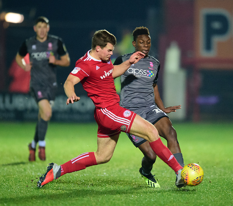 Lincoln City's Bernard Mensah vies for possession with Accrington Stanley's Matthew Platt<br /> <br /> Photographer Andrew Vaughan/CameraSport<br /> <br /> The EFL Checkatrade Trophy Second Round - Accrington Stanley v Lincoln City - Crown Ground - Accrington<br />  <br /> World Copyright © 2018 CameraSport. All rights reserved. 43 Linden Ave. Countesthorpe. Leicester. England. LE8 5PG - Tel: +44 (0) 116 277 4147 - admin@camerasport.com - www.camerasport.com