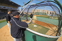 Head coach Chad Holbrook of the South Carolina Gamecocks watches batting practice before the Reedy River Rivalry game against the Clemson Tigers on March 1, 2014, at Fluor Field at the West End in Greenville, South Carolina. South Carolina won, 10-2. (Tom Priddy/Four Seam Images)