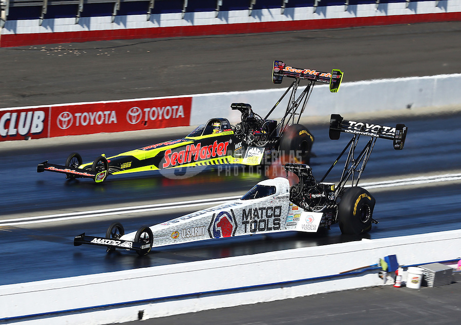 Feb 12, 2017; Pomona, CA, USA; NHRA top fuel driver Antron Brown (near) races alongside Troy Coughlin Jr during the Winternationals at Auto Club Raceway at Pomona. Mandatory Credit: Mark J. Rebilas-USA TODAY Sports