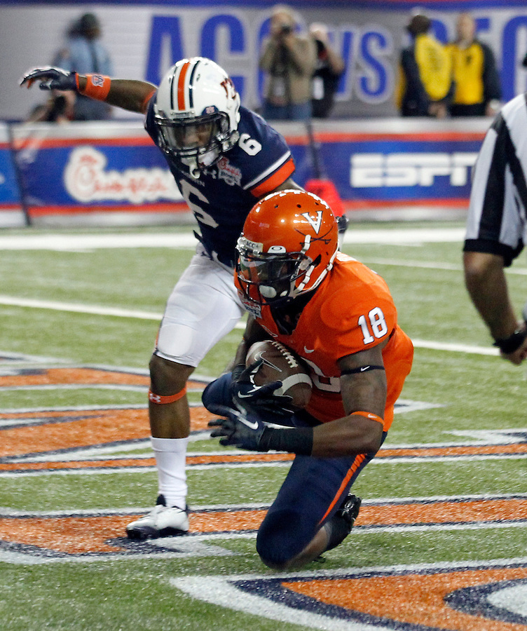 ATLANTA, GA - DECEMBER 31: Kris Burd #18 of the Virginia Cavaliers makes a touchdown catch in front of Jonathon Mincy #6 of the Auburn Tigers during the 2011 Chick Fil-A Bowl at the Georgia Dome on December 31, 2011 in Atlanta, Georgia. Auburn defeated Virginia 43-24. (Photo by Andrew Shurtleff/Getty Images) *** Local Caption *** Kris Burd;Jonathon Mincy