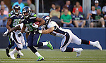 Seattle Seahawks wide receiver Golden Tate is grabbed by Denver Broncos Stewart Bradley while running back a kickoff at CenturyLink Field in Seattle, Washington on  August 17, 2013. The Seattle Seahawks beat the Broncos 40-10.     ©2013. Jim Bryant Photo. All Rights Reserved.