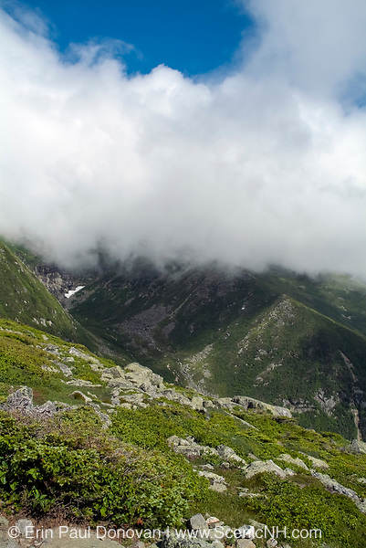 Clouds engulf Tuckerman Ravine from Boott Spur Trail during the summer months in the White Mountains of New Hampshire. Boott Spur Trail is located on the eastern slopes of Mount Washington.