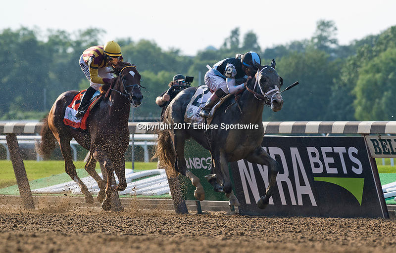 ELMONT, NY - JUNE 10: Tapwrit #2, ridden by Jose Ortiz, wins the 149th Belmont Stakes on Belmont Stakes Day at Belmont Park on June 10, 2017 in Elmont, New York (Photo by Scott Serio/Eclipse Sportswire/Getty Images)