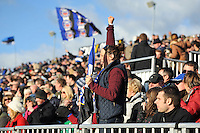 A Bath supporter in the crowd celebrates a score. Aviva Premiership match, between Bath Rugby and Exeter Chiefs on October 27, 2012 at the Recreation Ground in Bath, England. Photo by: Patrick Khachfe / Onside Images
