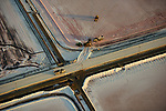 Pictured:  As water evaporates under the hot sun, these salt ponds are transformed into a beautiful patchwork of deep, earthy colours.<br /> <br /> Green, crimson, and orange hues are formed by the different microorganisms that reflect differing levels of salt in each pond in San Francisco, California.<br /> <br /> In the early stages, ponds match the blue-green colour of the seawater from the San Francisco bay which feeds them.<br /> <br /> As concentrations of salt increase, the pools turn an increasingly deep shade of crimson, before finally becoming a thick layer of salt, ready to be harvested by workers.  SEE OUR COPY FOR FULL DETAILS.<br /> <br /> Please byline:  Jassen Todorov/Solent News<br /> <br /> ©  Jassen Todorov/Solent News & Photo Agency<br /> UK +44 (0) 2380 458800