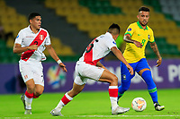 ARMENIA, COLOMBIA - JANUARY 19: Brazil's Matheus Henrique fights for the ball against Peru's Eduardo Rabanal during their CONMEBOL Pre-Olympic soccer game at Centenario Stadium on January 19, 2020 in Armenia, Colombia. (Photo by Daniel Munoz/VIEW press/Getty Images)