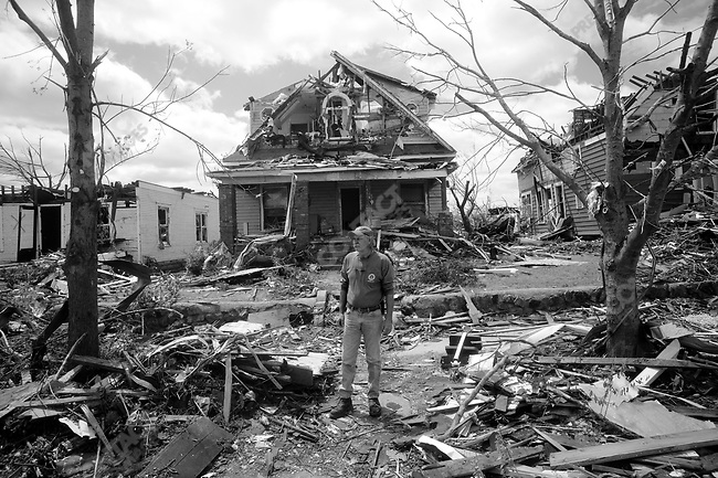 Dan Farren surveys the damage outside his destroyed home on Kentucky Street. Joplin, Mo, May 26, 2011..