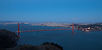 """Tale of Two Cities"" Golden Gate Bridge and San Francisco.  The sun is just setting on the Bridge with San Francisco and the entire Bay in the background.  In these 4 images of the sunset and twilight over the area you can see all of the lights that surround both SF Bay and the East Bay, both downtown SF and downtown Oakland, the Golden Gate Bridge and the Bay Bridge. Some have Alcatraz Island, Ellis Island, sailboats in the bay and airplanes flying overhead. Day or night, sunrise or sunset this is some of the most beautiful scenery in all of California if not the world."
