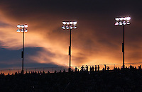 Fans atop the bleachers at Daytona International Speedway are silhouetted by the sunset while watching the NASCAR Busch Series Winn-Dixie 250 in Daytona Beach, Fl. (Rick Wilson/The Florida Times-Union)
