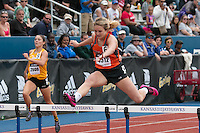 Oakland-Craig High School's Ashleigh Carr runs to victory in the 300-meter hurdles in 45.41 at the 2015 Kansas Relays.