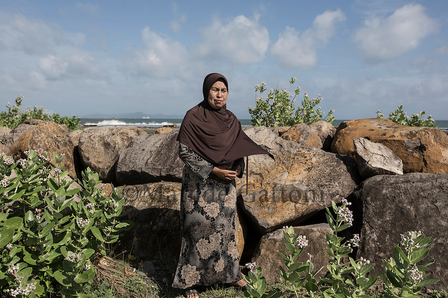 "Indonesia – Sumatra – Banda Aceh – Nurlaila, 48-years old lost her husband and one son during the tsunami. ""I still remember that day very well. I will never be able to forget it. I try to cope by being religious and telling to myself that it all came from God"". From that terrible experience that completely destroyed her house and life, Nurlaila was able to salvage only few thousands rupiahs and a praying book. Today, she lives in her new house in Lampulo, her home village, surviving thanks to a pension and by selling peanuts. ""It's hard"" she admits. ""I am alone and have to provide for my 23-year-old son, who is attending college. But my family got strength by the fact that a lot of people here had the same experience. We feel we are not alone""."