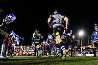 Henry Thomas and the rest of the Bath Rugby team run out onto the field. Aviva Premiership match, between Bath Rugby and Saracens on April 1, 2016 at the Recreation Ground in Bath, England. Photo by: Patrick Khachfe / Onside Images