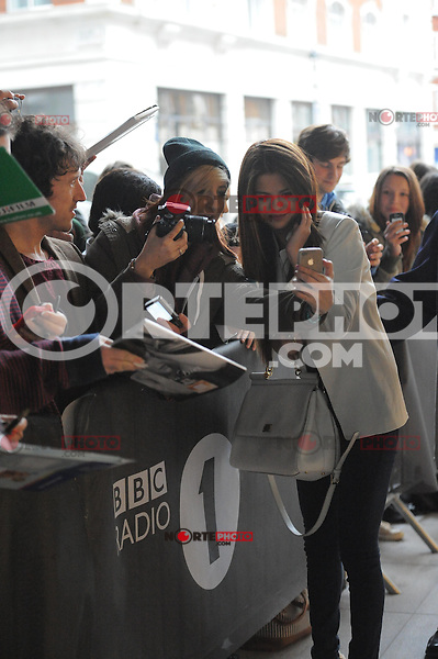 NONEXCLUSIVE.<br /> American pop star and actress Selena Gomez is pictured greeting fans while arriving at London's BBC Radio 1 studio...MAY 22nd 2013.<br /> ©NortePhoto