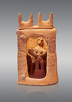 Minoan clay model shrine depicting a priestess playing the part of a goddess in a small single roomed house, Galatas 1700-1650 BC; Heraklion Archaeological  Museum, grey background.
