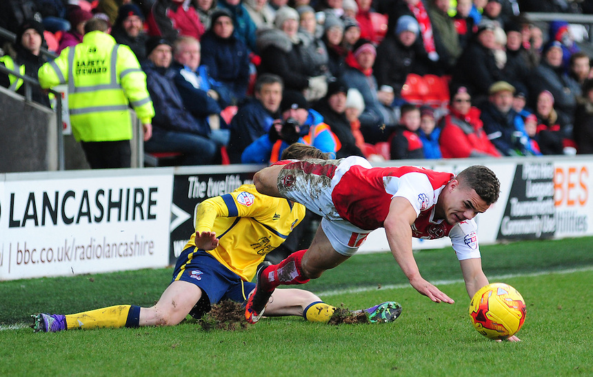 Fleetwood Town's Tyler Forbes is fouled by Scunthorpe United&rsquo;s Conor Townsend<br /> <br /> Photographer Chris Vaughan/CameraSport<br /> <br /> Football - The Football League Sky Bet League One - Fleetwood Town v Scunthorpe United  - Saturday 20th February 2016 - Highbury Stadium - Fleetwood    <br /> <br /> &copy; CameraSport - 43 Linden Ave. Countesthorpe. Leicester. England. LE8 5PG - Tel: +44 (0) 116 277 4147 - admin@camerasport.com - www.camerasport.com