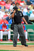 Home plate umpire Eric Cooper during a spring training game between the Boston Red Sox and Philadelphia Phillies at Bright House Field on March 24, 2013 in Clearwater, Florida.  Boston defeated Philadelphia 7-6.  (Mike Janes/Four Seam Images)