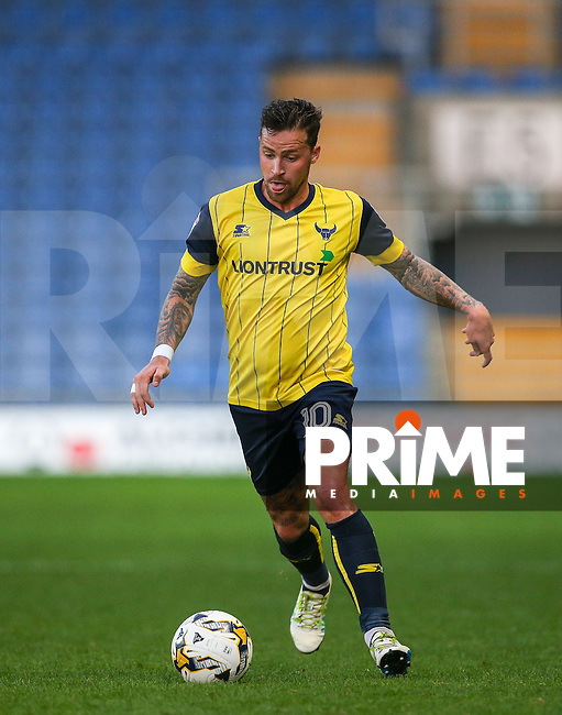 Chris Maguire of Oxford United on the ball during the The Checkatrade Trophy match between Oxford United and Exeter City at the Kassam Stadium, Oxford, England on 30 August 2016. Photo by Andy Rowland / PRiME Media Images.