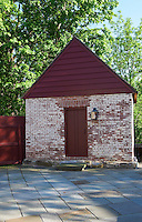 One of a number of brick-built outbuildings that flank the paved courtyard has been restored