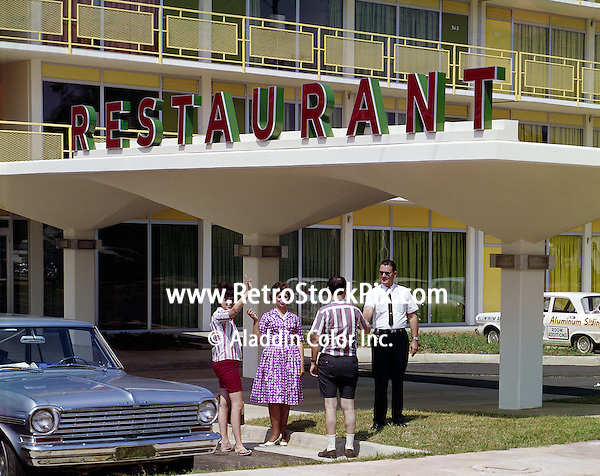 People at entrance of restaurant of the Holiday Inn in petersburg, Virginia. 1960's