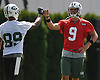 Bryce Petty #9, Quarterback, right, gives a fist bump to rookie Wide Receiver #89 Jalin Marshall during the first day of New York Jets team training camp at Atlantic Health Jets Training Center in Florham Park, NJ on Thursday, July 28, 2016.