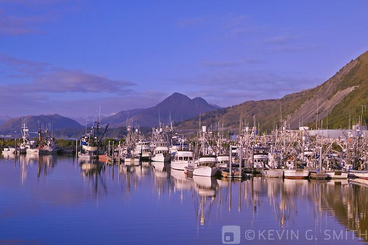 Fishing boats in St. Paul Harbor at sunrise, fall, Kodiak Alaska, USA.