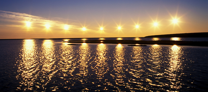 Midnight Sun, multiple exposure (9), shows the sun's path over the Arctic Ocean; July, 11:50 pm to 3:10 am, Turner River, Alaska National Wildlife Refuge, Alaska. 645 original ©Robin Brandt #41367