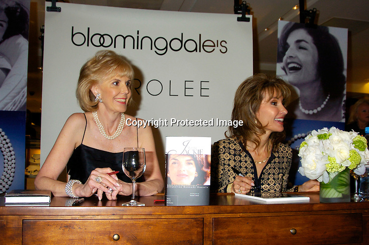 Tina Santi Flaherty and Susan Lucci ..at Bloomindales to sign Tina's new book, What Jackie Taught Us: Lessons from the Remarkabale Life of Jacqueline Kennedy Onassis. Susan Lucci signed photos of herself and the book, Jewelry designer Carolee ..donated proceeds from the sale of her jewelry to ..Little Flower Children's Services of New York.This took place on May 6, 2004..Photo by Robin Platzer, Twin Images