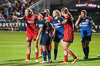 Kansas City, Mo. - Saturday April 23, 2016: Portland Thorns FC midfielder Allie Long (10) argues for a penalty kick on a foul at the edge of the box. FC Kansas City and Portland Thorns FC players line up for a corner kick during a match at Swope Soccer Village. The match ended in a 1-1 draw.