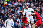 Karim Benzema of Real Madrid (C) heads the ball during the La Liga 2017-18 match between Real Madrid and Sevilla FC at Santiago Bernabeu Stadium on 09 December 2017 in Madrid, Spain. Photo by Diego Souto / Power Sport Images