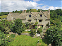 BNPS.co.uk (01202 558833)<br /> Pic: Strutt&amp;Parker/BNPS<br /> <br /> This picturesque home in the heart of the bucolic Slad valley where Laurie Lee grew up is the perfect place to enjoy the idyllic country life - and you can even make your own cider for Rosie.<br /> <br /> The Grade II listed Knapp House, which has a cider press in the next-door barn, is believed to be the spot where the cider referred to in the famous book was made.<br /> <br /> The beautiful Cotswolds property is set in the Slad Valley, which was immortalised in the novel and is where the author spent his childhood.<br /> <br /> Now one lucky buyer can follow in Laurie Lee's footsteps as the property is on the market for &pound;2million with Strutt &amp; Parker.